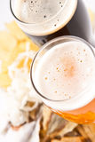 Beer with snack. Dark and light beer with any snack Stock Image