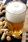 Beer and snack nuts snack time Stock Images