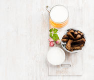 Beer snack set. Pint of pilsener in mug and rye bread croutons with garlic cream cheese sauce over white painted old Stock Photo
