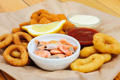 Beer snack, shrimps, calmar rings and fish sticks Stock Photo
