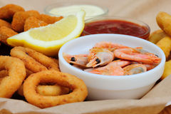 Beer snack, shrimps, calmar rings and fish sticks Royalty Free Stock Photography