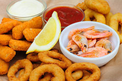 Beer snack, shrimps, calmar rings and fish sticks Royalty Free Stock Images