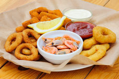 Beer snack, shrimps, calmar rings and fish sticks Stock Photography