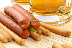 Beer and snack-smoked sausage Stock Images