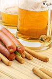 Beer and snack-smoked sausage Royalty Free Stock Image