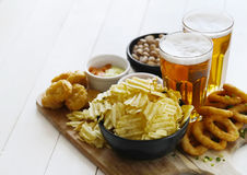 Beer and snacks. Alcohol and food. Beer with snacks on the table stock photo