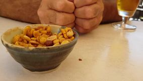 Beer snacks, aperitif against the background of hands stock video footage