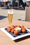 Beer and snacks. Beer and warm fried snacks, dutch bitterballen: stuffed fried meatballs stock image