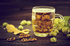 Beer and snacks on black wooden table. Draft cold beer in glass Stock Photo