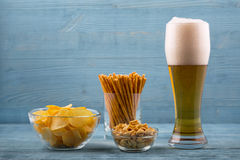 Beer and snacks, chips, bread sticks and peanuts Stock Photography