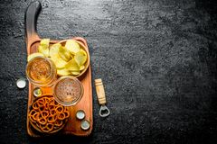 Beer and snacks on the cutting Board stock images