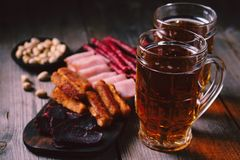 Beer and snacks. oktoberfest food. appetizers set. Beer and snacks. bar table. restaurant, pub, oktoberfest food. delicious lager drink and appetizers set- fried royalty free stock images