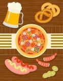 Beer and snacks: pizza, sausage, pistachio, shrimp, pretzels Stock Photography