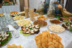 Beer with snacks, potato chips, peanuts, bacon, cucumbers, party or pub concept. buffet. Beer with snacks, potato chips, peanuts, bacon, cucumbers, party or pub stock photo
