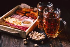 Beer and snacks. restaurant, pub, oktoberfest food. Beer and snacks. bar table. restaurant, pub, oktoberfest food. delicious lager drink and appetizers set stock photos