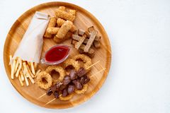 Beer snacks set, bar table. pub, oktoberfest food. Beer snacks set, bar table. restaurant, pub, oktoberfest food. french fries, breaded fried cheese sticks stock photography