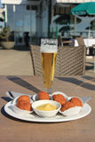 Beer and snacks. Beer and warm fried snacks, dutch bitterballen royalty free stock image