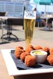 Beer and snacks. Beer and warm fried snacks, dutch bitterballen: stuffed fried meatballs stock images