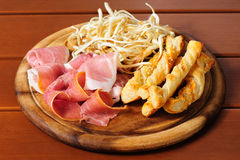 Beer snacks on wooden plate Stock Photo