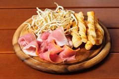 Beer snacks on wooden plate Stock Image