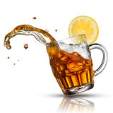 Beer splash in glass with lemon Stock Image