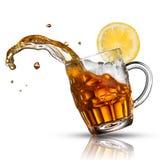 Beer splash in glass with lemon Stock Image