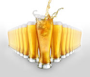 Beer. Splash on the white background royalty free stock photos