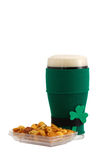 Beer in St Patrick Beer Glass with snack Stock Photography