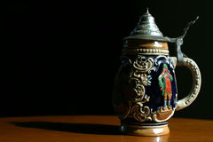 Beer Stein. A traditional German beer stein with very dramatic lighting Stock Images