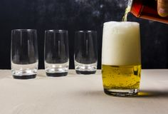 Pouring beer into a beer stein. Beer stein filled with beer beverage can Stock Photography