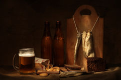 Beer still life. With fishes and bread Royalty Free Stock Photography