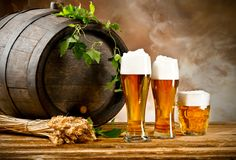 Beer still life. Beer keg with glasses of beer and blur background royalty free stock photography
