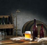 Beer still life. On the table with old keg of beer and tap Stock Photography