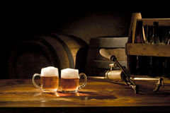 Beer still life. On the table with old keg of beer and tap Royalty Free Stock Photo