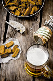 Beer style - beer and crackers on a wooden table. royalty free stock images