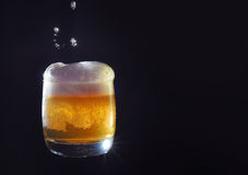 Beer suds. Glass of Beer with drops Royalty Free Stock Photo