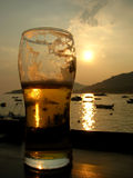 Beer sunset. Glass of beer and sunset over the sea Stock Photos