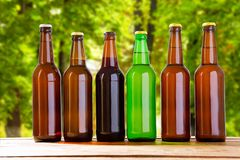 Beer on table on blurred park background, summer drinks,many coloured bottles.  royalty free stock photo