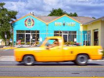 Beer and Tacos. Fast truck speeding yellowtruck street road local restaurant smalltown town speeding cloudy storm taqueria Royalty Free Stock Image