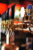 Beer taps inside pub Stock Photo