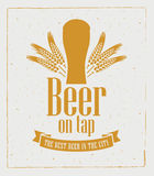 Beer on tap. Banner with a picture glasses of beer on tap with ears of wheat Royalty Free Stock Photos