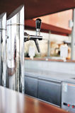 Beer tap at the bar Royalty Free Stock Photos