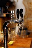 Beer Tap in a Bar. Blur background. Stock Photo