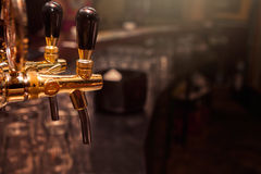 Beer tap in the bar Stock Image