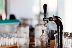 Beer tap in a bar during day time Royalty Free Stock Photo