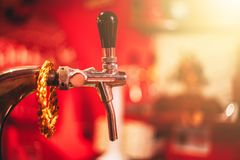 Beer tap. Draught Beer Tap in a Bar with copy space for text royalty free stock photos