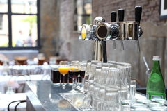 Beer tap and glasses Stock Photography