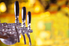 Beer tap. With golden beer-toned background Royalty Free Stock Image