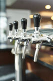 Beer tap row Stock Images