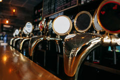 Beer tap in a row pub. Beer tap in a row in pub bar Royalty Free Stock Photography